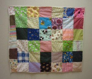 Various patches of fabric quilted together