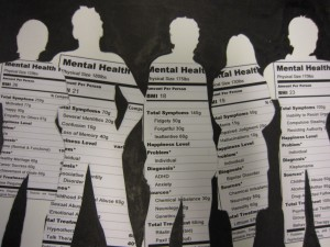 White silhouette of people with mental health facts printed inside.