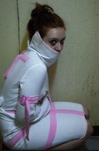 Girl in straight jacket