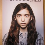 "Digital image of a girl with the words ""SPOT THE MADNESS"" printed above."