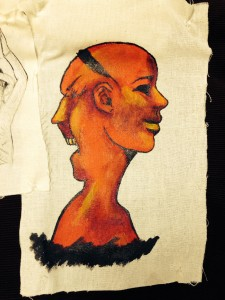 An illustration of a double sided head on a piece of fabric.