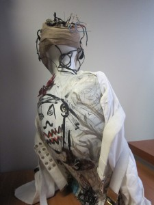 Female manikin with multiple media attached to it.