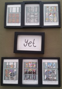 "A series of 7 framed drawings, 3 above a drawing that says ""yet"", and 3 below"