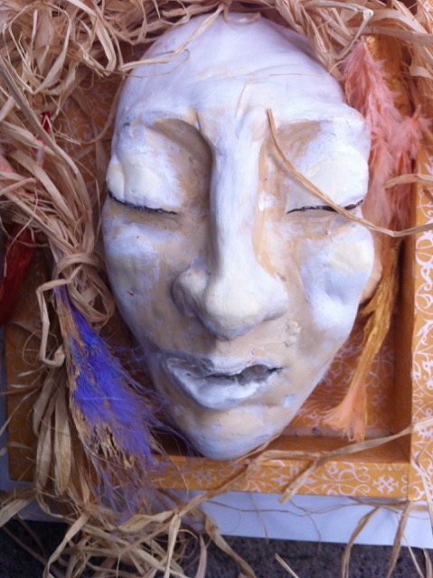 Photograph of a mask with eyes closes